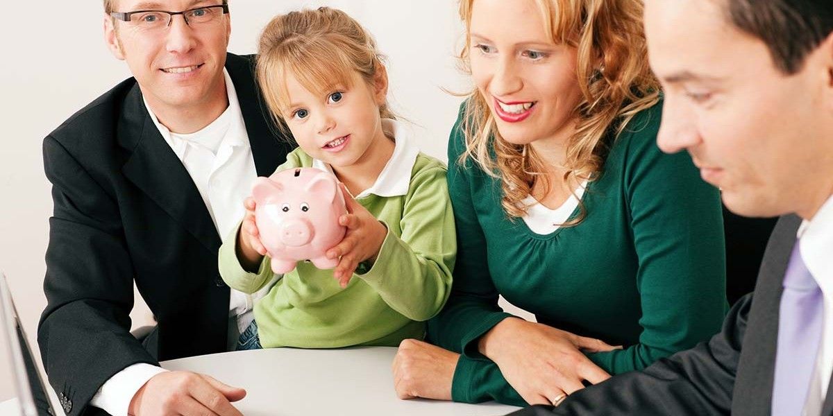 couple with child holding piggybank receiving financial planning advice