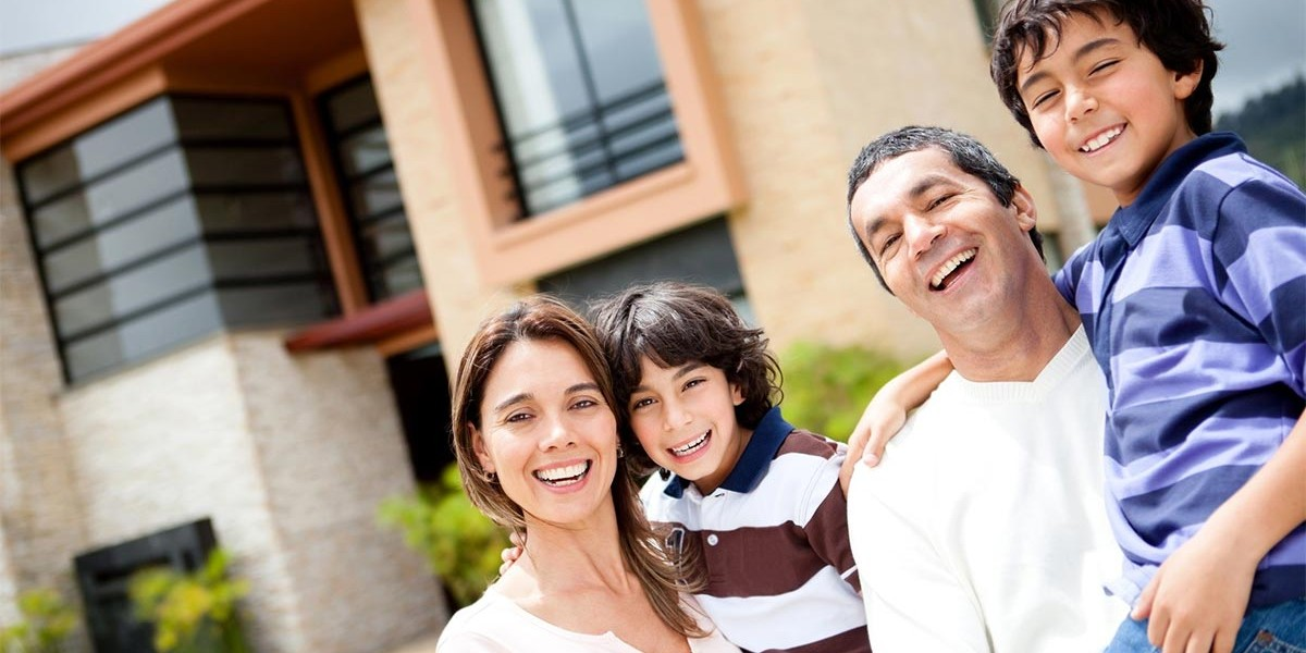 Australian Family Smiling Out Front of House