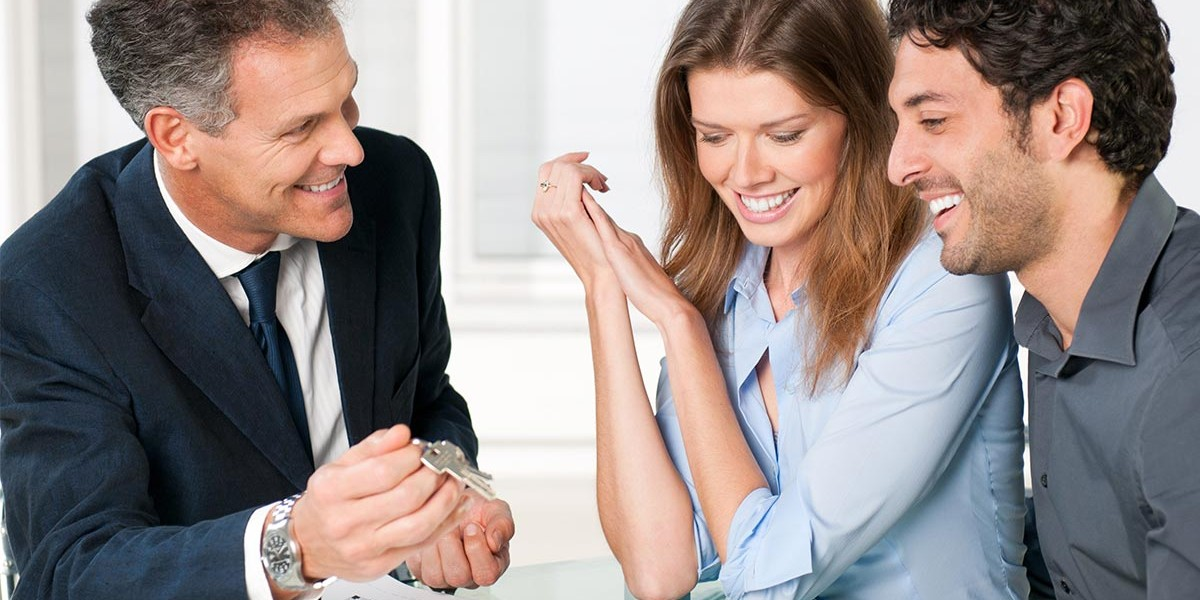 young couple talking to mortgage broker